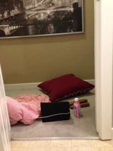 ahh the lovely space outside of the bathroom door...classy place to sleep